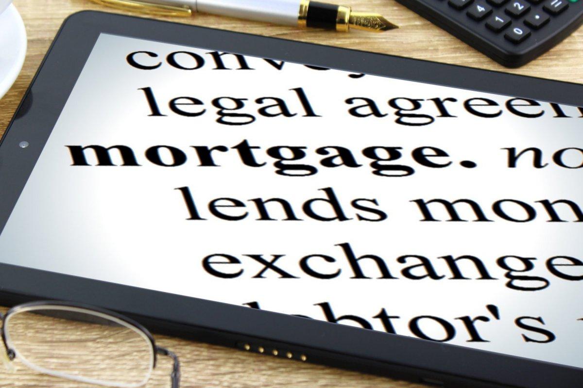 How Do Mortgage Refinances Affect Debt, Default, and Spending?